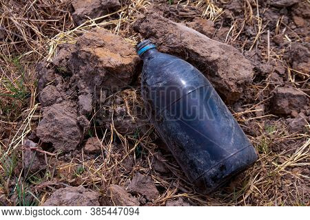 Bottle Glass Insecticide Garbage On The Farmer Ground, Polluted Waste Concept, Garbage Waste Of Pest