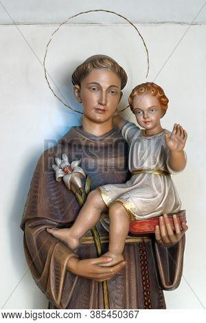 ZAGREB, CROATIA - MAY 19, 2014: Saint Anthony holds a child of Jesus, a statue in the parish church of Saint Anthony of Padua in Zagreb, Croatia