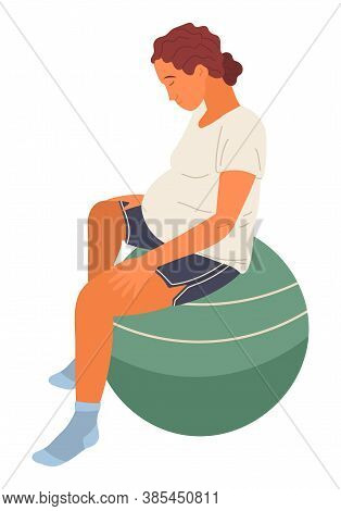 Pregnant Woman In White T-shirt And Shorts Sits On Green Big Fitness Ball, Relaxes, Meditates. Mater
