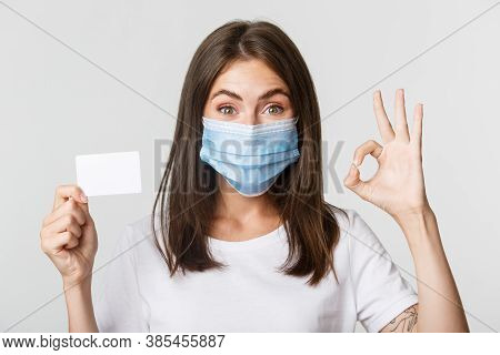 Covid-19, Health And Social Distancing Concept. Close-up Of Smiling Brunette Girl In Medical Mask, S