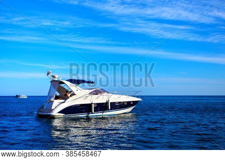 Motorboat In The Sea Against Blue Sky. Seascape
