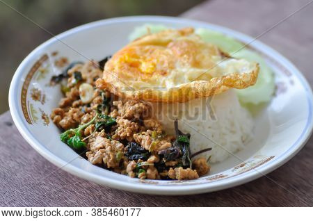 Stir Fried Pork With Chili Paste, Holy Basil And Fried Egg And Rice