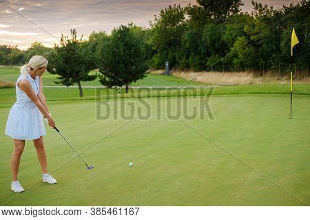 Player Woman Hit Ball Into Golf Tee .