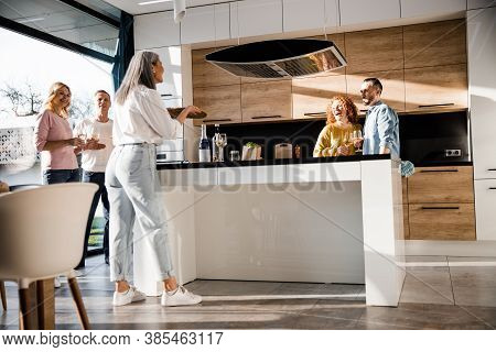 Pretty Woman Treating Pizza To Her Guests At Home