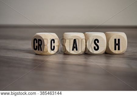 Cubes And Dice With The Words Crash And Cash On Wooden Background