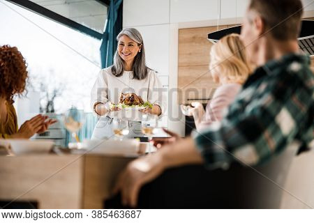 Guests Are Sitting At The Dining Table In Living Room