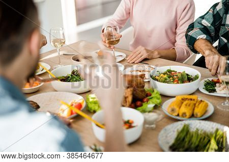 Guests Sitting At The Table During A Festive Dinner