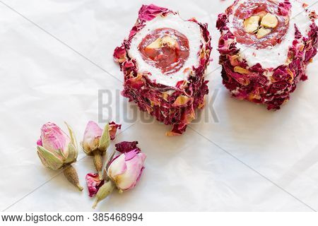 Turkish Delight With Nuts And Rose Leaves. Rahat Lokum, Traditional Turkish Sweets, Turkey.