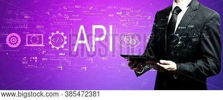 Api - Application Programming Interface Concept With Businessman Using His Tablet Computer