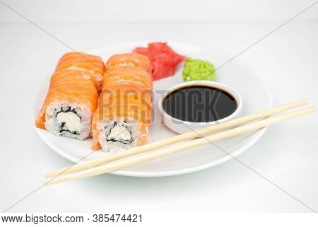 Philadelphia Maki Rolls With Soy Sauce, Pink Ginger, Wasabi On White Background, Asian Food, Japanes