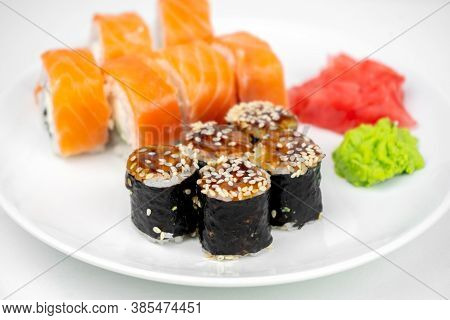 Philadelphia Maki Rolls And Eel Unagi Maki With Soy Sauce, Pink Ginger, Wasabi On White Background,