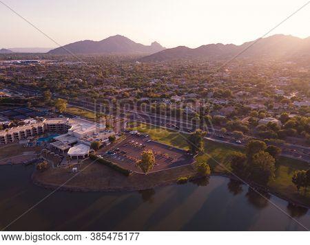 Early evening image of Scottsdale, Arizona,USA with view of camelback Mountain on horizon.