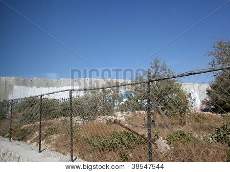 BETHLEHEM, OCCUPIED PALESTINIAN TERRITORIES - OCTOBER 05: Israeli separation wall in the West Bank town of Bethlehem on October 05, 2006.