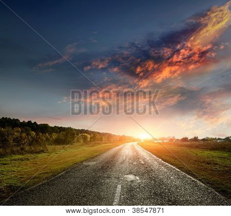 paved country road with surprisingly beautiful sky