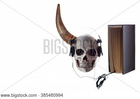 Human Skull With A Horn. Skull With Toy Cars. Listen To Literature.