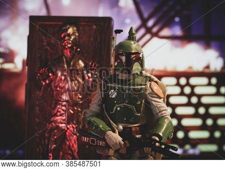 SEPTEMBER 13 2020: Scene from Star Wars The Empire Strikes Back - Han Solo frozen in carbonite with Bounty Hunter Boba Fett - Hasbro action figure