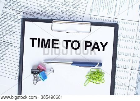 Text Time To Pay On Folder With Clip. Pen With Paper Clips On Financial Table