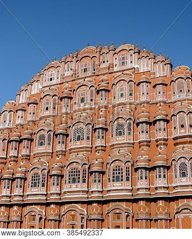 Facade Of The Ancient Palace Of Winds With Lots Of Windows And Turrets On A Sky Background, Jaipur,