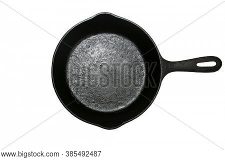 Cast Iron Frying Pan. Isolated on white. Room for text. Cast Iron Skillet.
