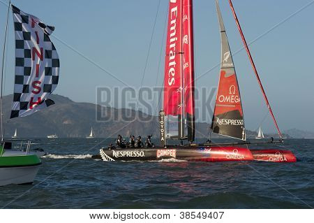 SAN FRANCISCO, CA - OCTOBER 4: Emirates Team New Zealand crosses the finish line in the America's Cup World Series sailing races in San Francisco, CA on October 4, 2012