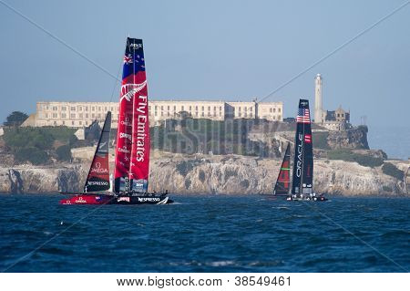 SAN FRANCISCO, CA - OCTOBER 4: Emirates Team New Zealand and Oracle Team USA sail in front of Alcatraz in the America'??s Cup World Series sailing races in San Francisco, CA on October 4, 2012