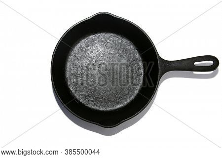 Cast Iron Frying Pan. Isolated on white. Room for text. Cast Iron Skillet with shadow on white.