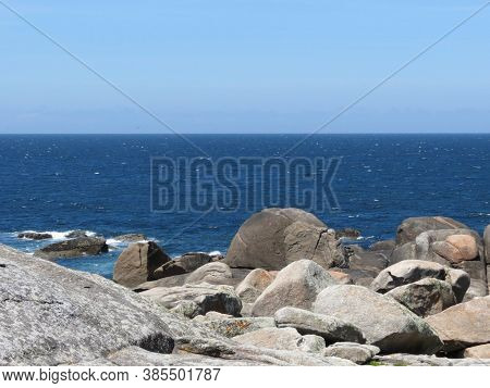 Huge Water Polished Ancient Sacral Stones On The Beach In Muxia, Spain, Seen From The Side Of Church