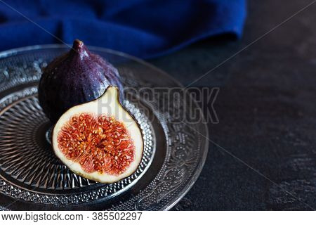 Fresh Ripe Fig Fruits On Black Background.