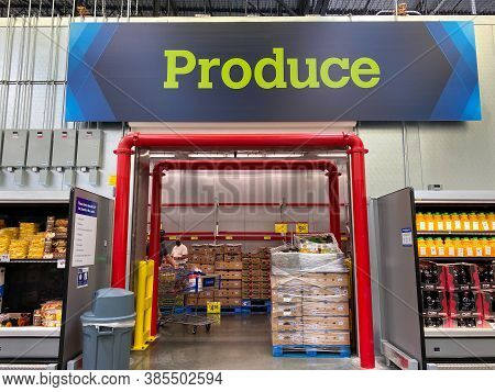 The Produce Sign Above The Refrigerated Produce Room  At A Sam's Club Warehouse Store In Orlando, Fl
