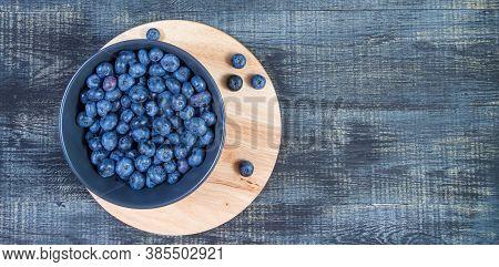 Blueberry Berry In Dark Gray Ceramic Bowl On Dark Blue Wooden Background.