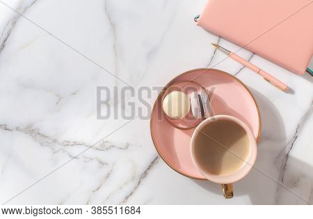 Pink Coral Colored Diary For The Year 2021, Pen, Coffee, Macaron Cookie On Straw Woven Placemat