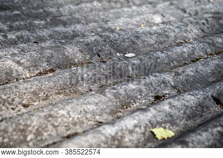 Asbestos Slate. Roofs Of Houses And Farm Buildings. Environmentally Unfriendly And Harmful To Human