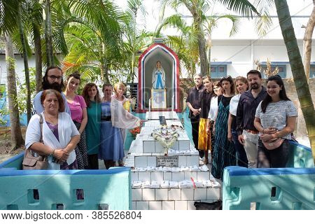 KUMROKHALI, INDIA - FEBRUARY 28, 2020: Pilgrims from Croatia at the Tomb of the Croatian Missionary, Jesuit Father Ante Gabric on the occasion of his 105th birthday in Kumrokhali, West Bengal, India