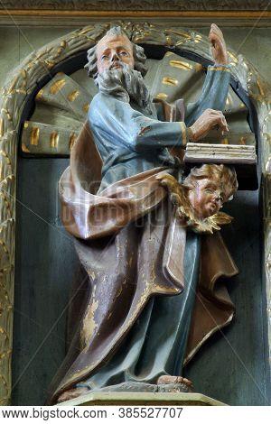 SVETI IVAN ZELINA, CROATIA - JUNE 26, 2013: Saint Matthew the Evangelist statue at the pulpit in the parish church of Saint John the Baptist in Sveti Ivan Zelina, Croatia