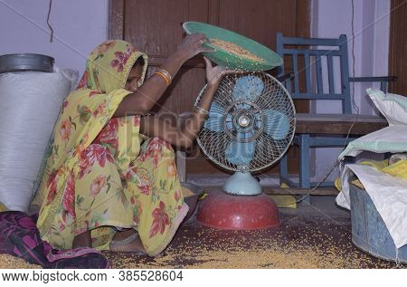 Karakbel, Madhya Pradesh/india : April 30, 2020 - Rural Indian Woman Cleaning Grain At Home