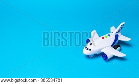 Toy White Plane On A Blue Background Banner With A Place For Text For A Toy Store And Airline Compan