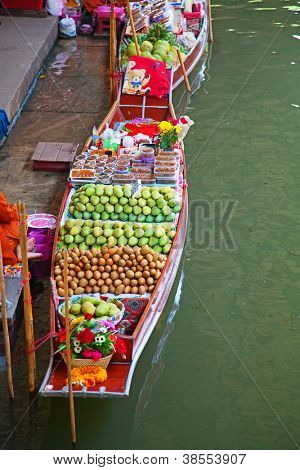 RATCHABURI, THAILAND - FEB 20: A Thai fruits at Damnoen Saduak floating market on February 20, 2011 in Ratchaburi, Thailand.The local market is popular for traditional style food and old Thai culture.