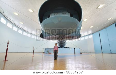 STAR TOWN - FEBRUARY 4: Girl near big centrifuge in Cosmonaut Training Center named of Gagarin on February 4, 2012 in Star town near Moscow, Russia. World largest centrifuge CF-18.