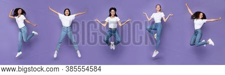 Five Multiracial Women Jumping Posing In Mid-air Having Fun Over Purple Background, Smiling To Camer