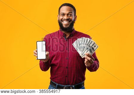 Cashback, Easy Online Money Transfer Concept. African American Guy Holding Cellphone With White Blan