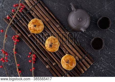 Moon Cake Yolk Pastry, Mooncake For Mid-autumn Festival Holiday, Top View Design Concept On Dark Woo