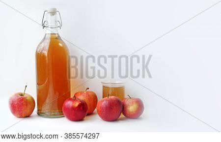 Banner Of A Bottle And Glass With Natural Apple Juice. Apple Cider Drink Of Fermented Fruit Drink An