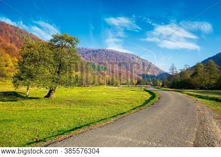 Country Road Winding Through The Valley. Wonderful Autumn Landscape In Mountains. Forest On Hills In
