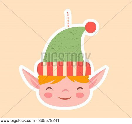 Cute Little Elf Christmas Tree Ornament With Pointy Ears And Happy Grin Over A Pastel Background, Co