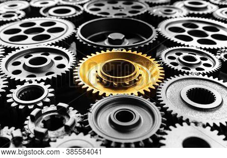 Keyman,key Success Or Leadership Concepts With Metal Gold Cog Outstanding In Another Cogs.business P