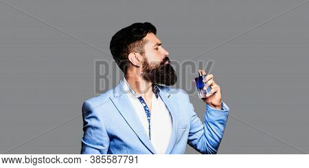 Masculine Perfume, Bearded Man In A Suit. Perfume Or Cologne Bottle And Perfumery, Cosmetics, Scent
