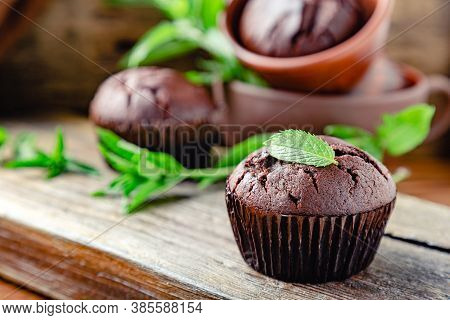 Cupcakes With Mint Leaf On Top. Chocolate Cupcake Muffin With Mint Leaves In Rustic Style. Fresh Bak