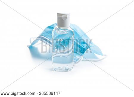 Antibacterial hand gel and face mask isolated on white background. Coronavirus protection.