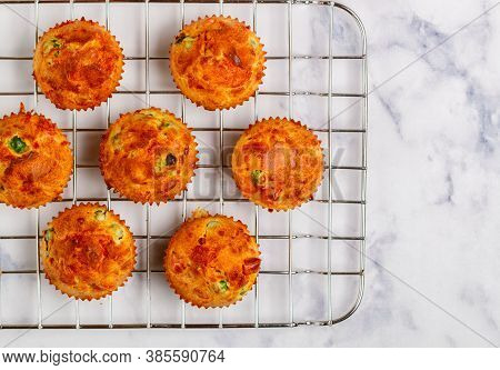 Delicious Freshly Baked Homemade  Savory Muffins With Parmesan Cheese, Sausage Or Ham And Green Peas