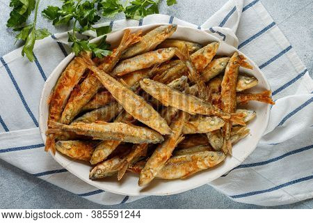 Fried Smelt . Delicious Small Fish In A White Plate. Gourmet Appetizer. Selective Focus, Top View